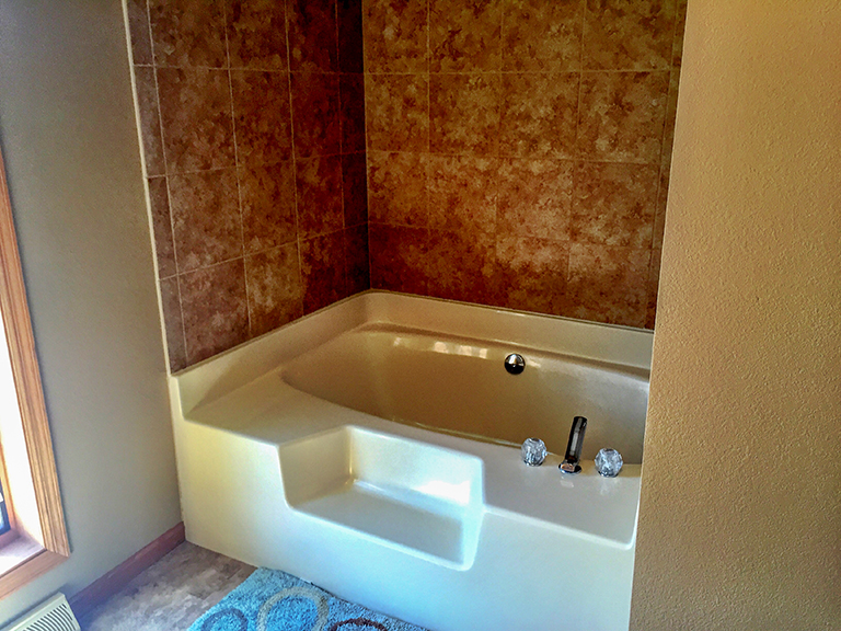 Large tub and tile shower.